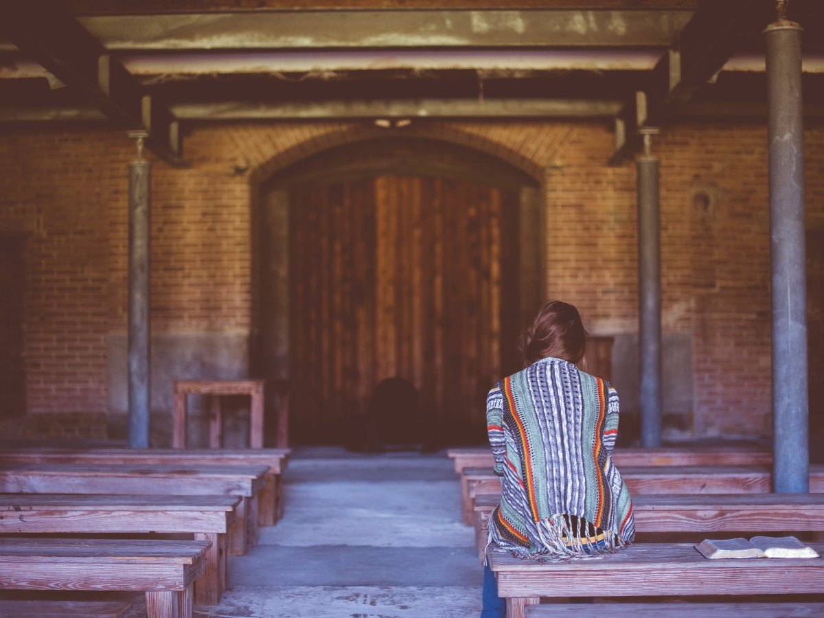 woman church alone infertility support